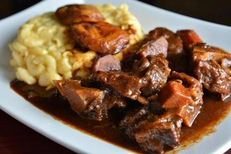 Slow-braised Oxtail with mac 'n' cheese and fried plantain.