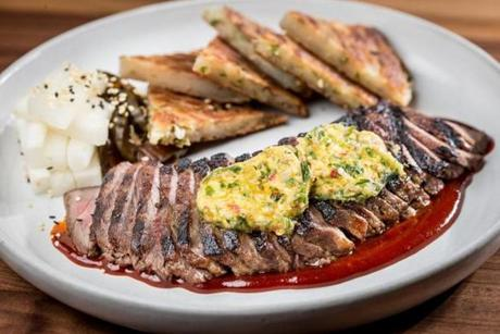 New York strip loin and scallion pancakes.