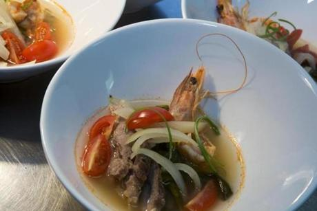 Sinigang, a savory-sour soup with pork and shrimp.