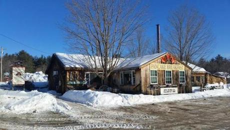 08sugaring - Opened weekends only, BentonÕs Sugar Shack on Rte. 175 in Thornton, NH is worth stopping for the belt-busting breakfasts.. (Mike Benton)