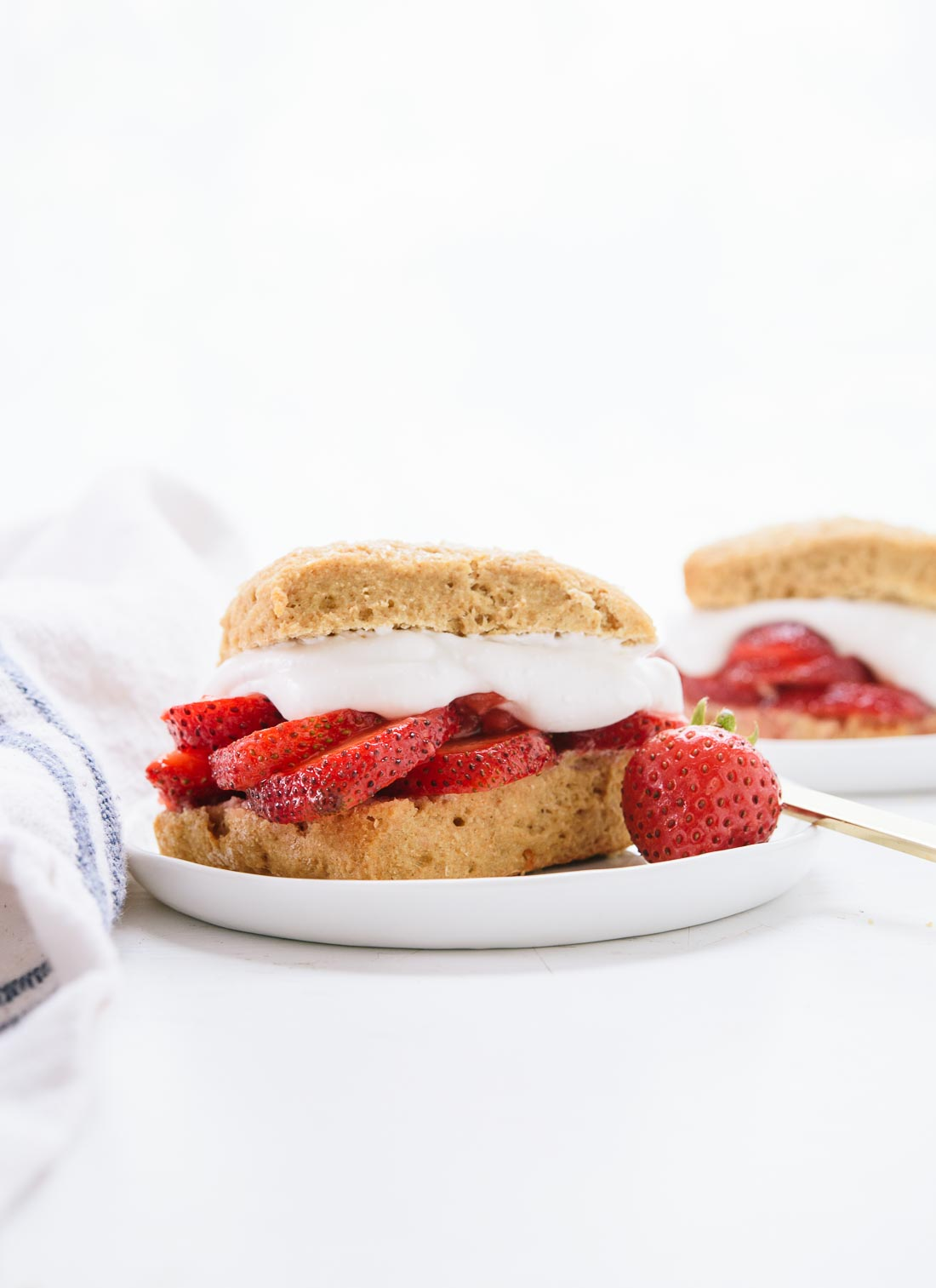 This healthier strawberry shortcake recipe is naturally sweetened, 100% whole grain and made with coconut milk instead of heavy cream! It's delicious and easy to make, too. cookieandkate.com