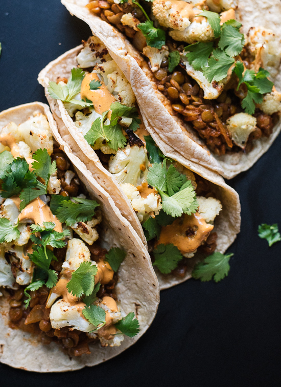 Roasted cauliflower, seasoned lentils and creamy chipotle sauce combine to create an unexpectedly delicious taco! - cookieandkate.com