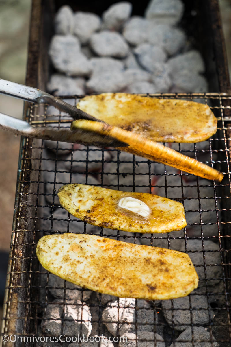 Cook the best grilled potato by slicing it finely, grill until blistered on the surface and creamy in texture. Add cumin and chili powder to spice it up.