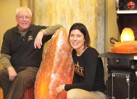 Portsmouth, NH 020615 Owners Don and Judit Tydeman (cq) posed next to a 500 pound rock of Himalayan salt at the Salt Cellar in Portsmouth, NH, Friday, February 6 2015. (Wendy Maeda/Globe Staff) section: Lifestyle slug: 25salt reporter: Jane Dornbusch
