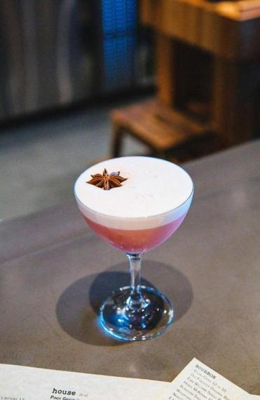A dynamic duo serves up cranberry sour in the backroom