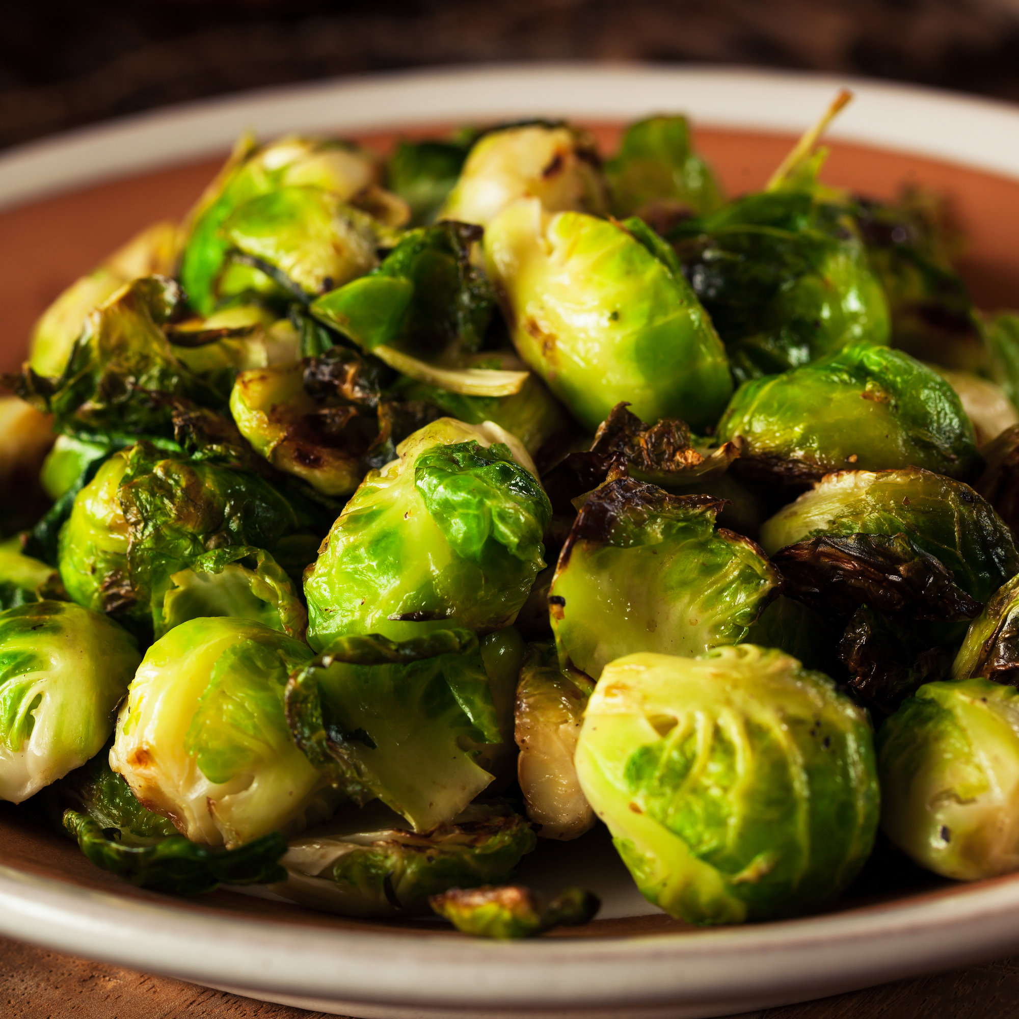 Learn How to Make Caramelized Brussels Sprouts and Kale With Crispy Capers