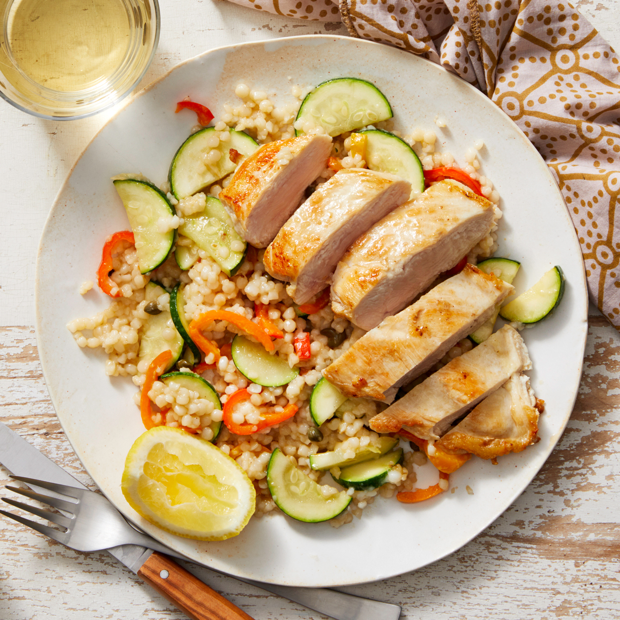 Seared Chicken over Couscous with Peppers, Zucchini, & Caper-Butter Sauce
