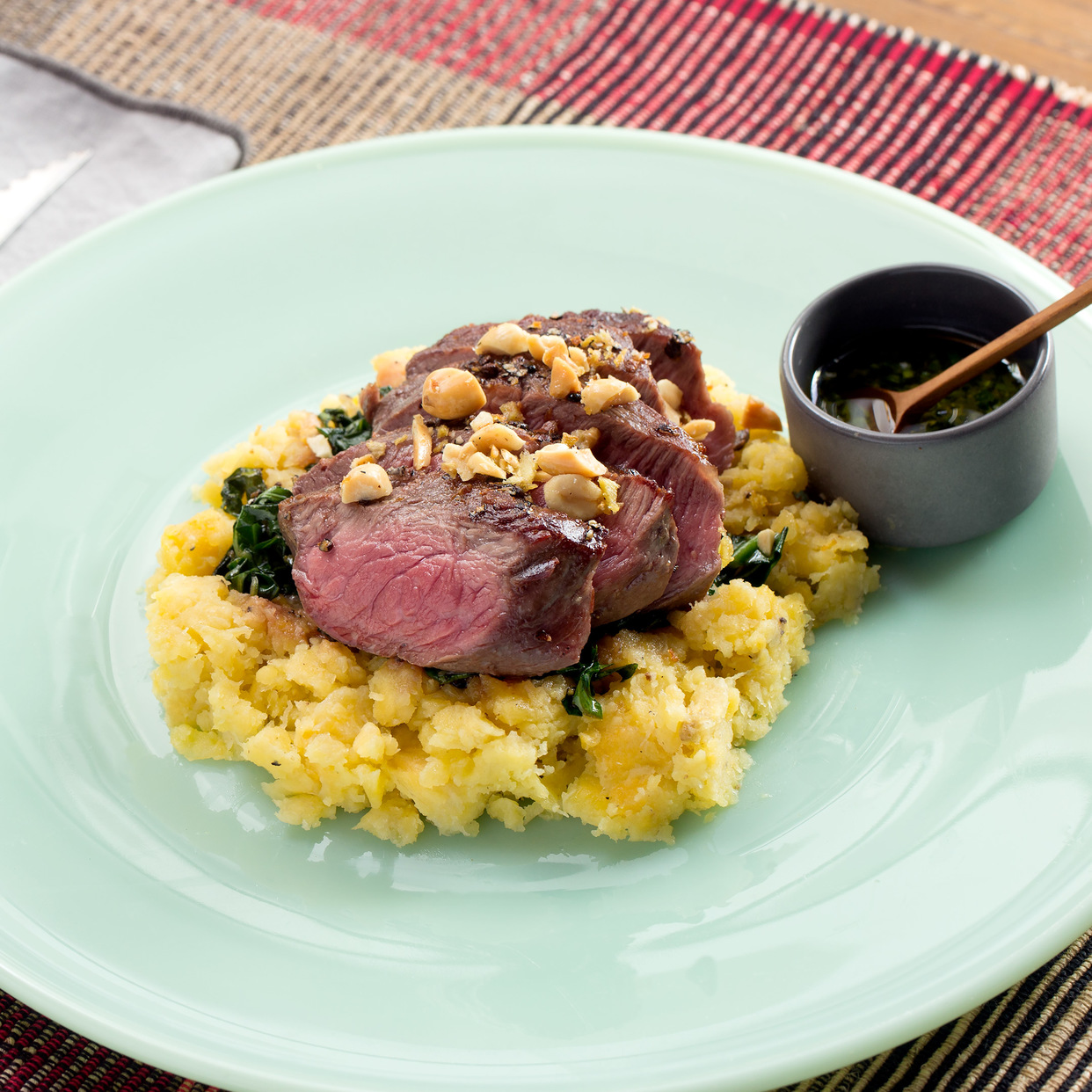 Grains of Paradise-Crusted Steaks with Mashed Plantain, Collard Greens & Ginger Peanuts